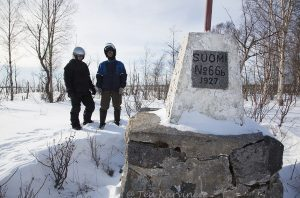 1038 – The border of Sweden and Finland. Men are in Sweden and snow machines are in Finland on the island of Inakari